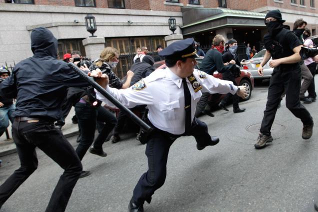 police striking someone